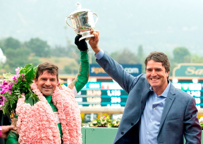 Jockey Kent Desormeaux, left, and trainer J. Keith Desormeaux, right, celebrate after Exaggerator's victory in the Santa Anita Derby - © BENOIT PHOTO