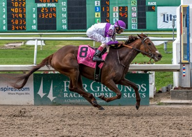 Land Over Sea winning the Fair Grounds Oaks (gr. II) at Fair Grounds - Photo by Lou Hodges, Jr. / Hodges Photography