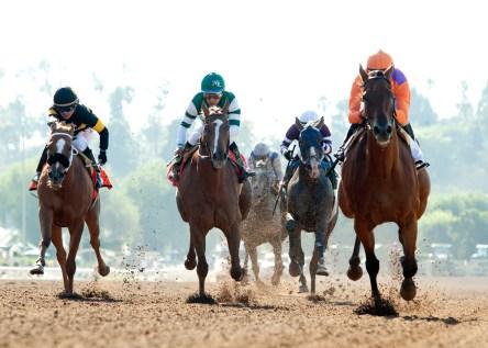 Spendthrift Farm's Beholder and jockey Gary Stevens, right, overpower Stellar Wind (Vicitor Espinoza), second from left, and Finest City (Tyler Baze), left, to win the Grade I, $400,000 Vanity Mile, Saturday, June 4, 2016 at Santa Anita Park, Arcadia CA. © BENOIT PHOTO