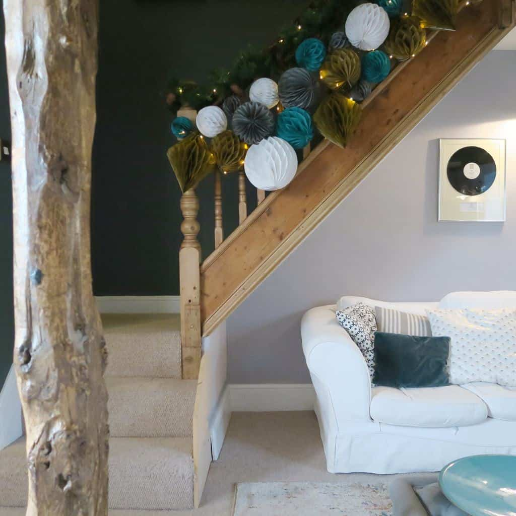 Alternative Christmas Decor   Decorating a Staircase with Honeycomb Balls