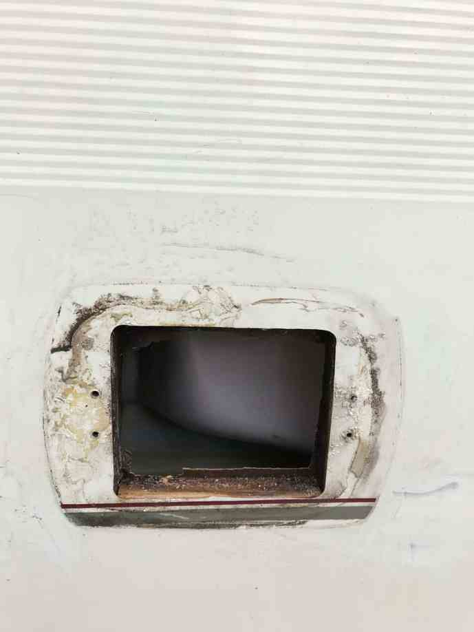 Removing vent covers makes it easier to paint a caravan exterior