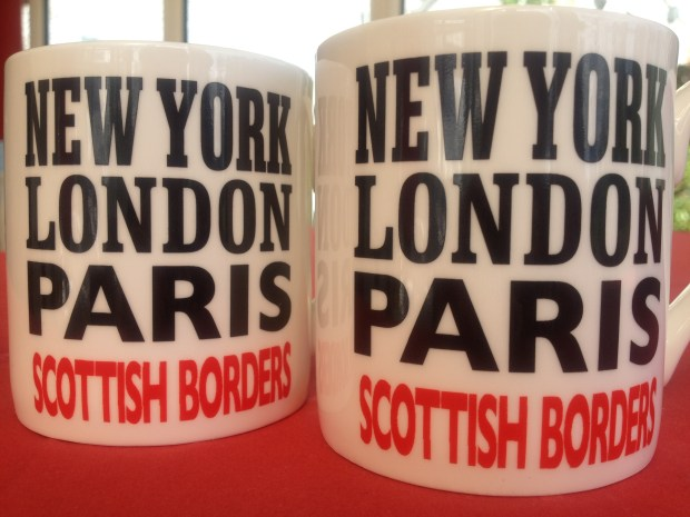 Mug with words New York, London, Paris, Scottish Borders