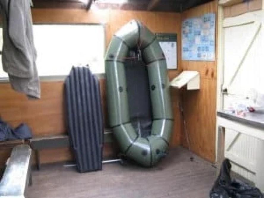 Packraft and Big Agnes mattress/floor inside Supper Cove Hut