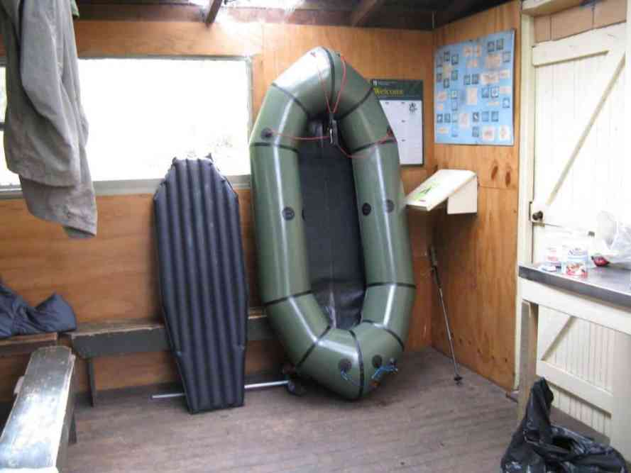 Packraft and Big Agnes mattress/floor inside Supper Cove Hut