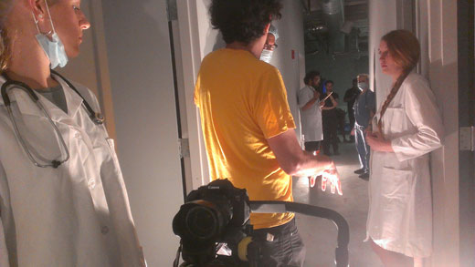 Michael gives direction during a hallway scene. (Photo - D.Hixon)