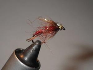Side view on the vice of finished Red Midas fly