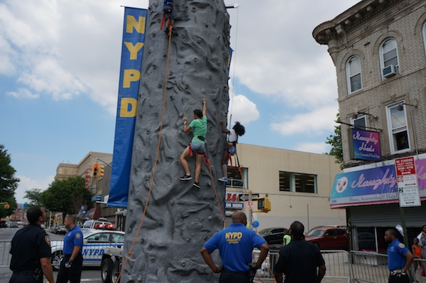 Uni Librarian Stephanie Yee likes challenges. On her break, she took on the NYPD climbing wall which was set up next to us.