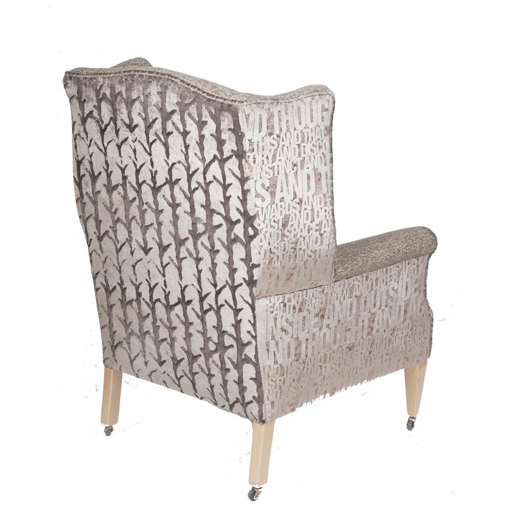 Edwardian wingback armchair on original casters