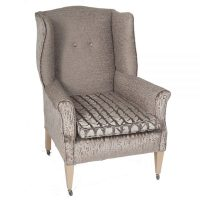 Edwardian wingback armchair on original casters