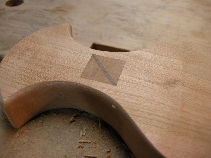 Once the glue is set, cut away the waste with a flush-cut saw.