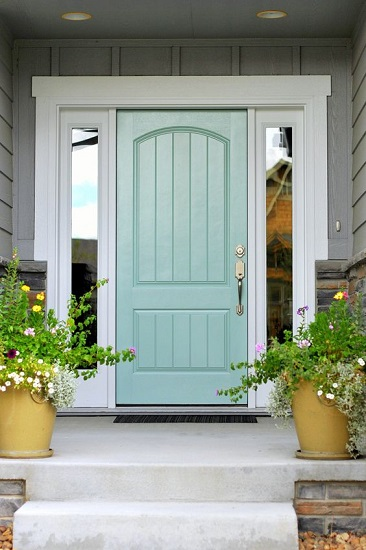 22. Turquoise blue Front doors gives a good warm hug