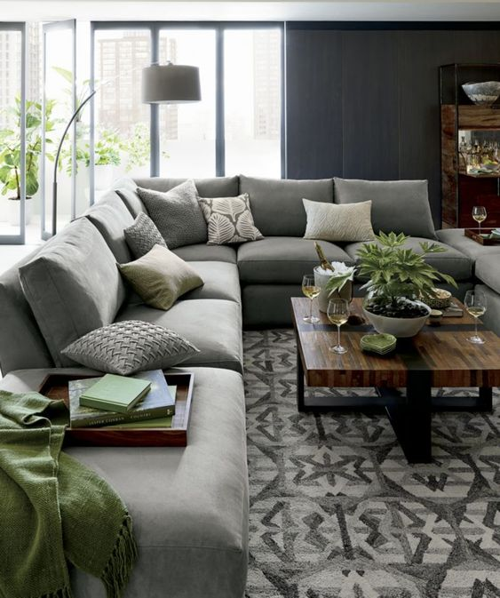 Elegant L Shape Sofa Surrounded With Pretty House Plants
