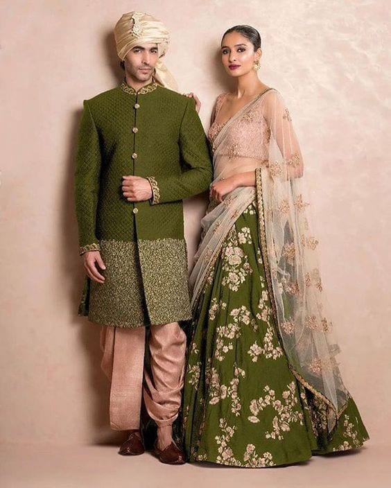 Green and beige Sangeet outfit for couple