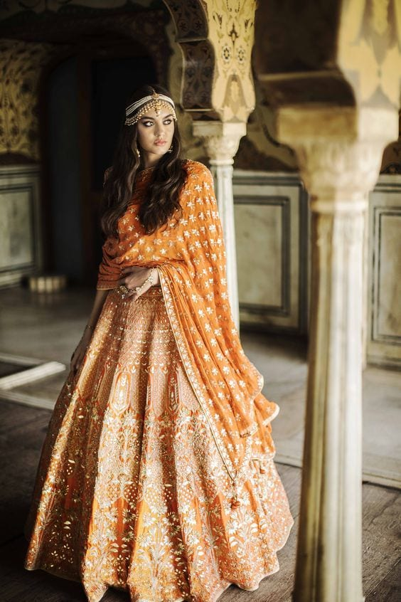 Wedding Ceremony in orange lehenga