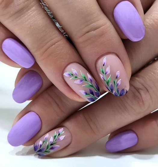 Pretty floral printed nail with lavender polish