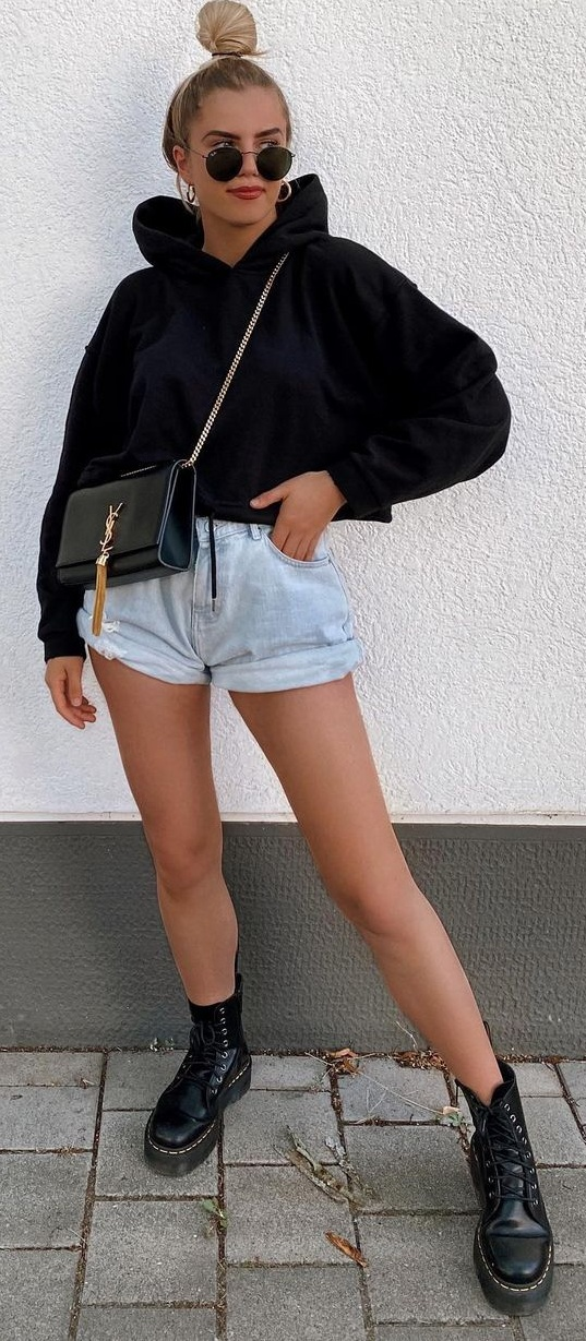 Cool and Casual Black Hoodie and Denim Shorts Teamed With Boots, Sunglasses and Sling
