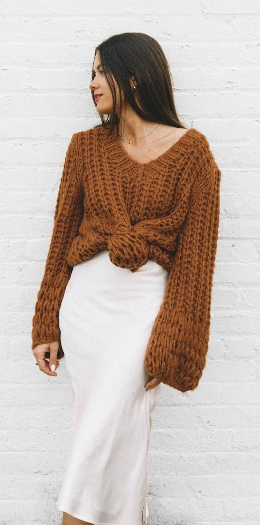 Oversize Brown Knit Sweater Teamed With White Silk Skirt for a stylish look