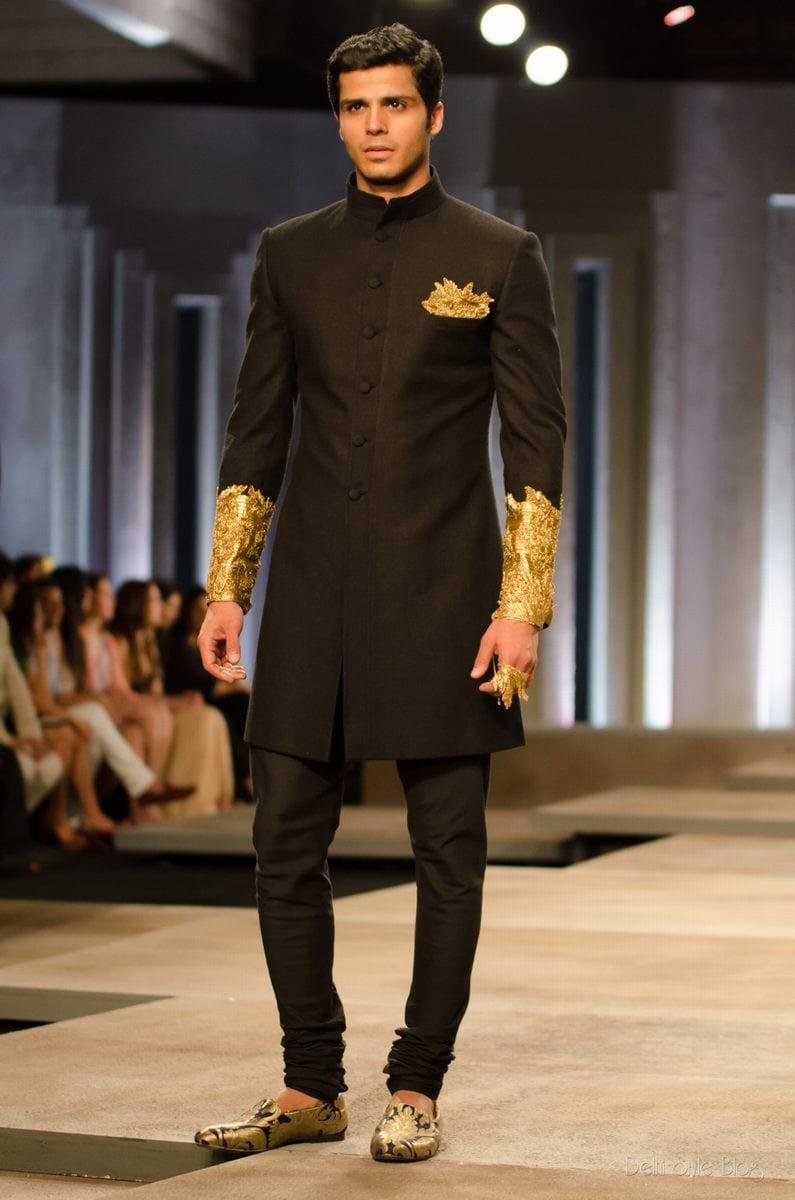 black sherwani with golden pattern