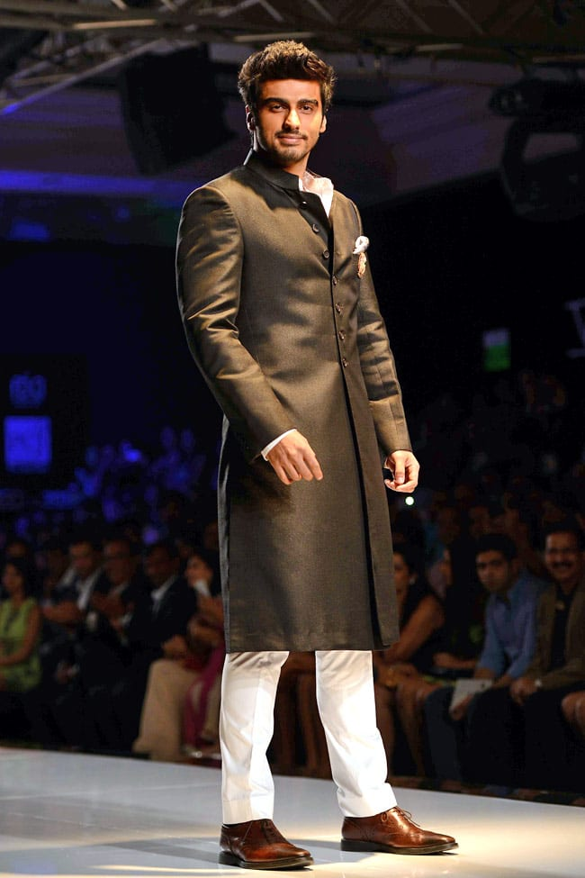 black sherwani with shoes and white pant