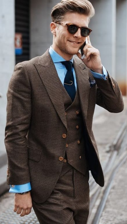 brown suit with blue shirt