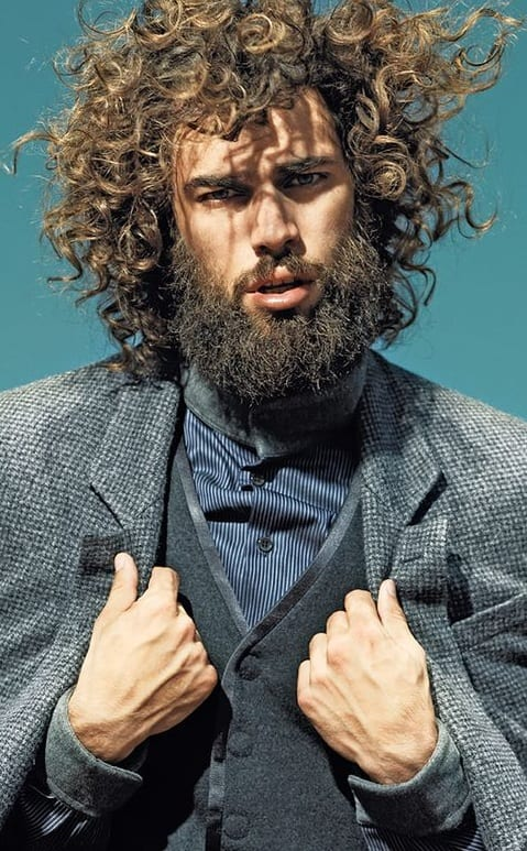curly hairstyle and beard