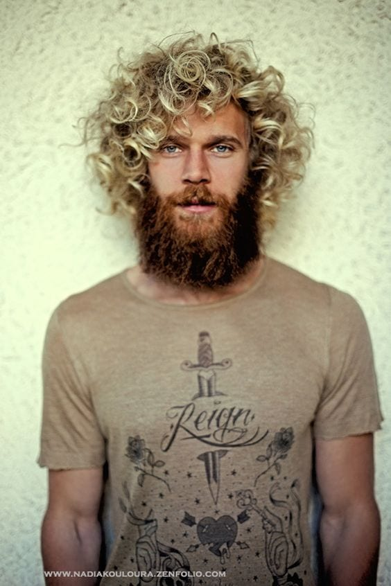 curly hairstyle with beard