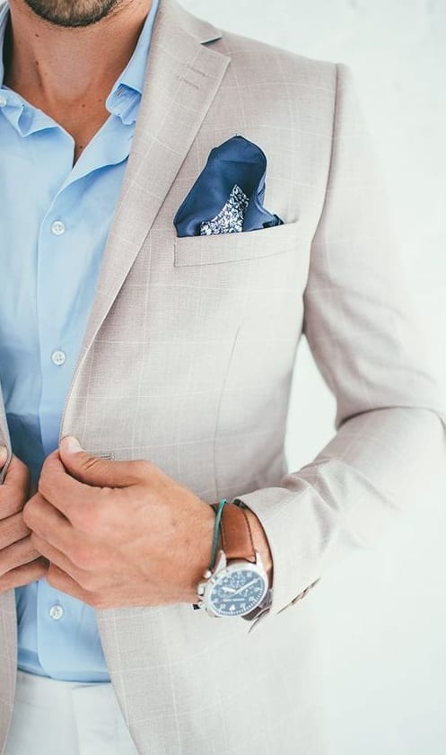 navy blue pocket square with white suit