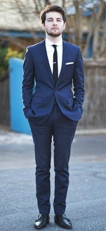 navy blue suit, black tie, black shoes