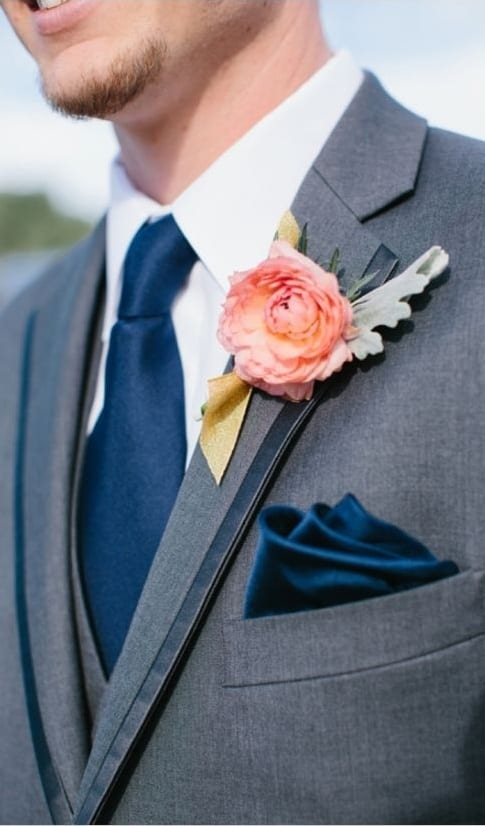 navy blue tie with lapel flower