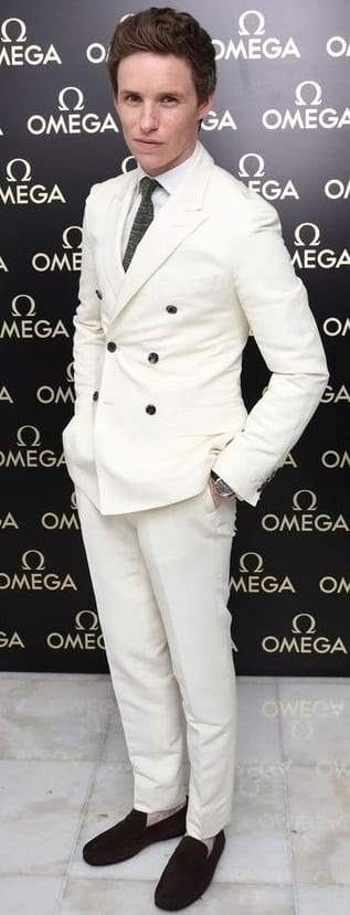 All white suit with black tie and loafers