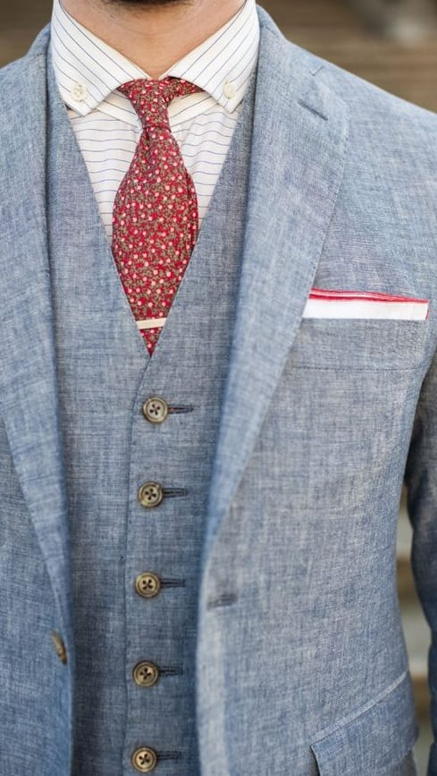 Blue suit red tie look for yacht party