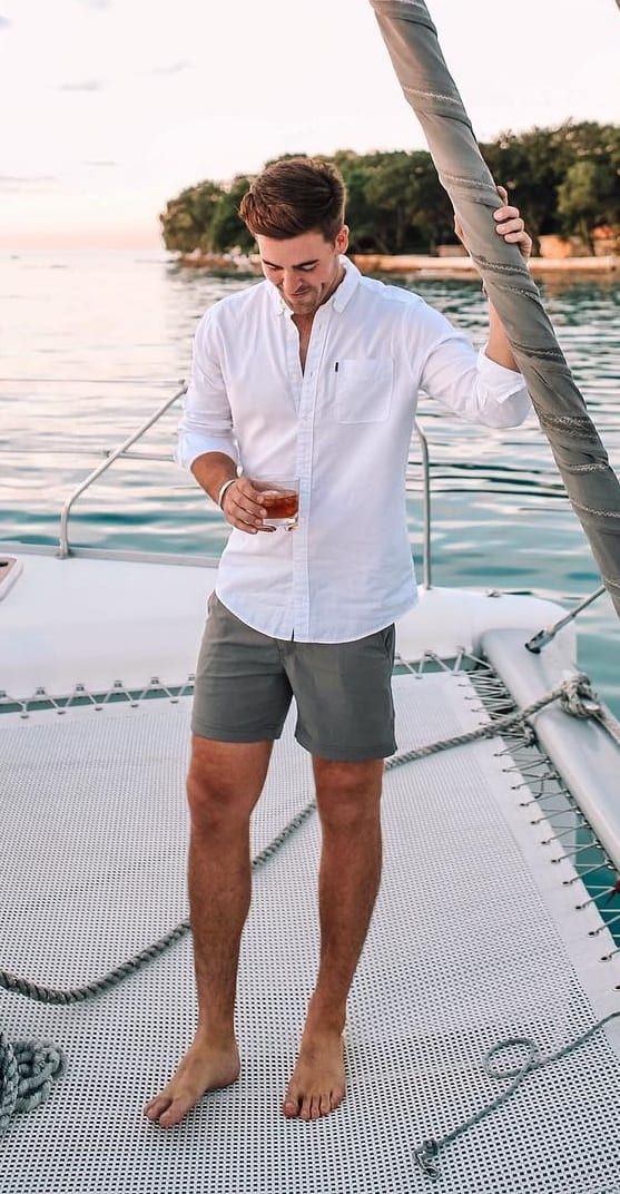 Grey shorts white shirt for yacht party