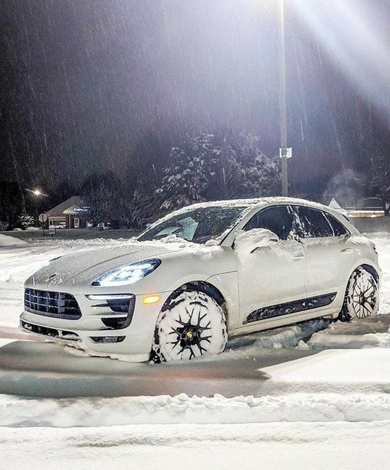 PORSCHE SUV IN SNOW