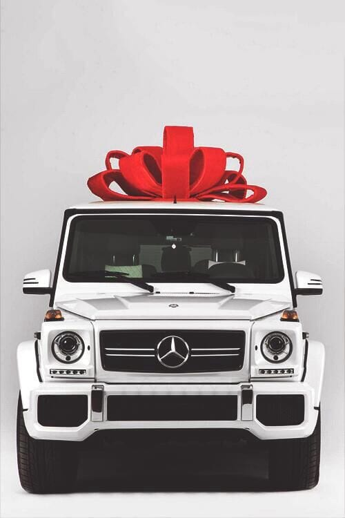 White Mercedes G Wagon with a red bow
