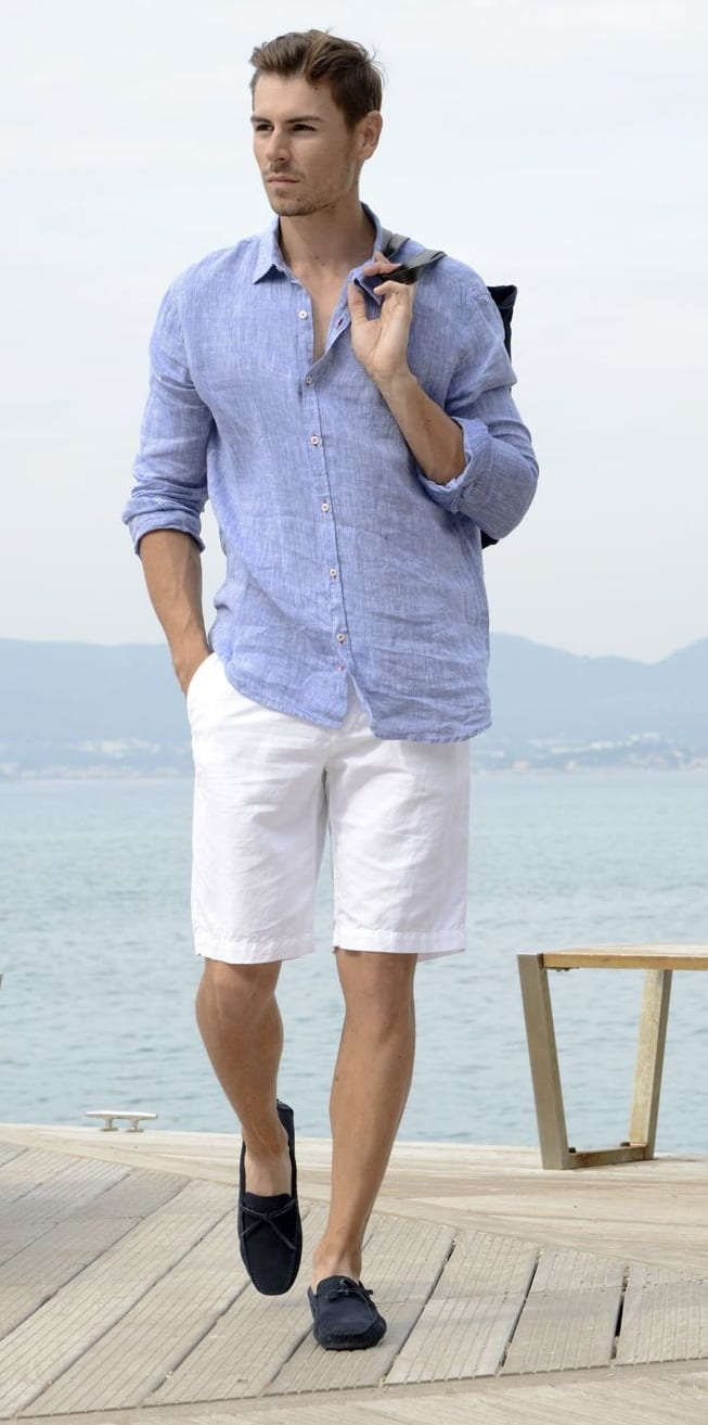 White shorts with pastel blue linen shirt for yacht party