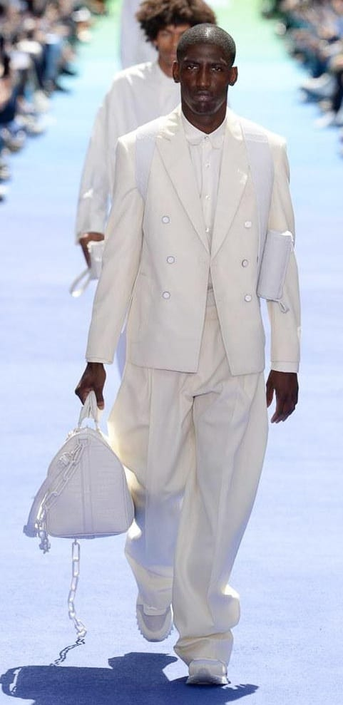White suit and white sneakers with a white bag