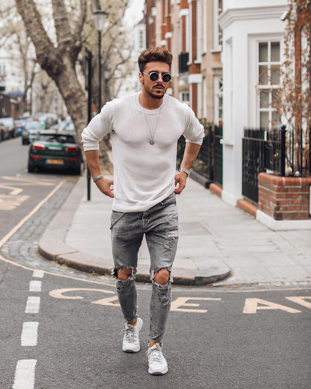 White t shirt,grey ripped jeans and black round sunglasses