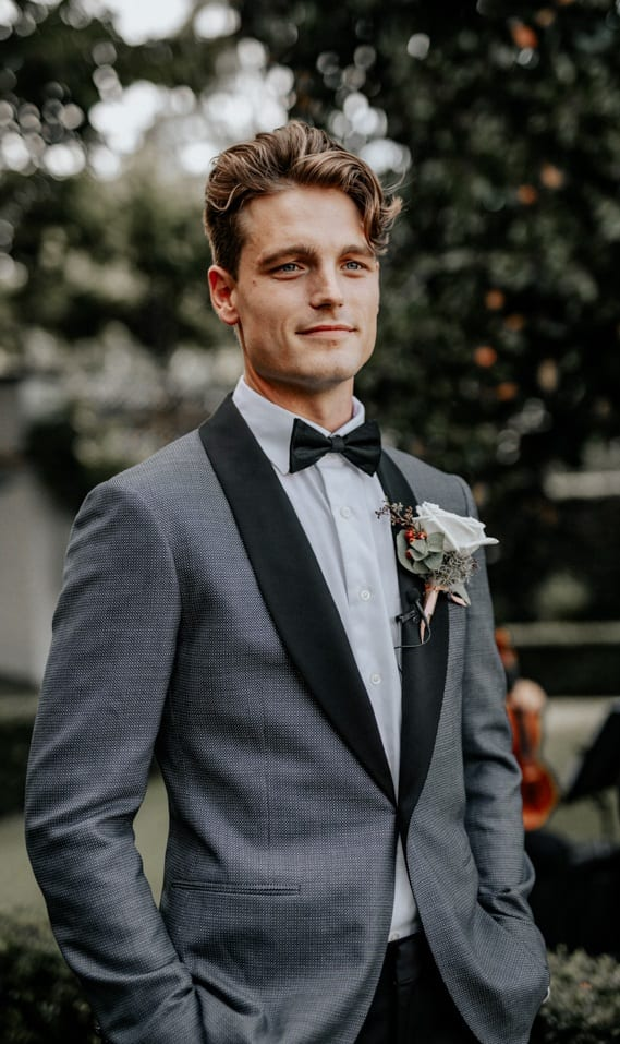 Grey Tuxedo Suit, Bow Tie and Boutonniere for the Groom