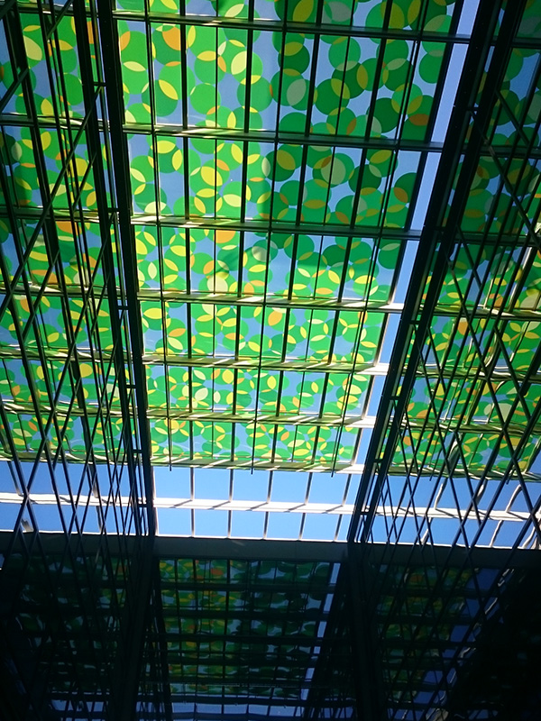 An artwork by Spencer Finch is featured in the canopy above an alley in an Amazon building in Seattle's South Lake Union.