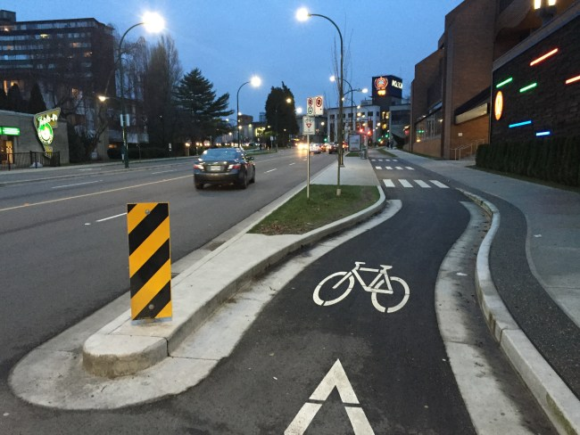 Bus island with shared space for pedestrians and bikes in Vancouver, BC.