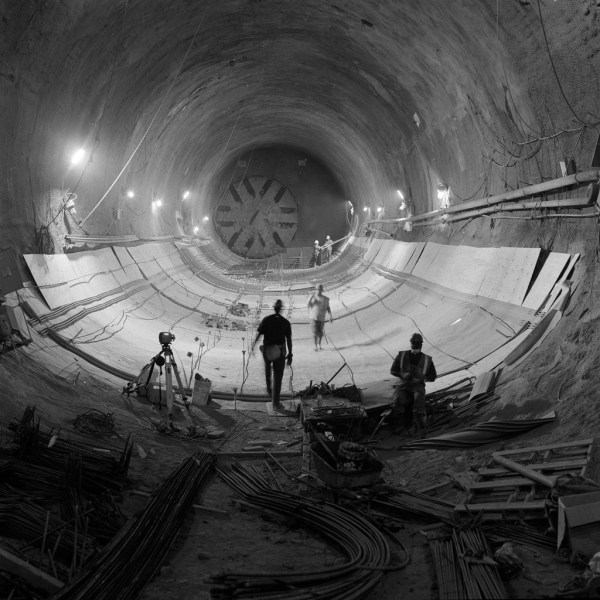 Beacon Hill Station; this photo shows the difference in size of the area excavated using NATM/STM versus the TBM tunnel tube with the cutterhead visible in the background like a giant fan. (Sound Transit)
