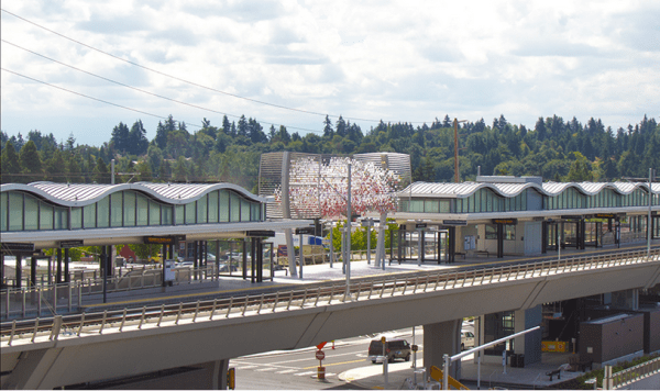 """The """"Cloud"""" sculpture looms over the elevated Angle Lake Station. (Sound Transit)"""