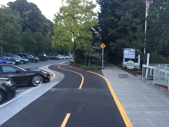 Where the cycletrack bends around a landscape area.