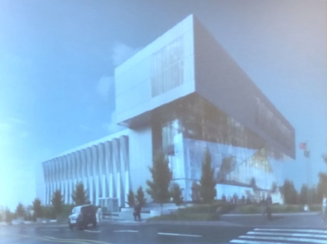 The rendering presented at the meeting reflects the trimmed parking ramp.