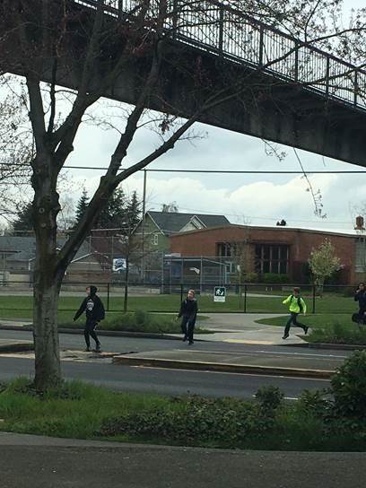 Students crossing Holman Rd NW at-grade below the underpass. (City of Seattle)