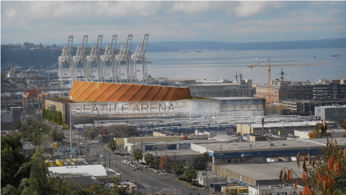 Plans for a SoDo Arena, as rendered here, fell through, but the many industrial acres that Chris Hansen acquired for the purpose could be converted to new industrial and/or commercial development. The outcome would ride on what industrial lands policy is. Note, the Port of Seattle cranes in the background. (Credit: SiteWorkshop)