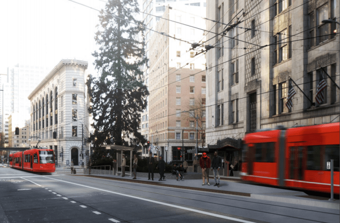 A photo a red streetcar running in downtown Seattle.