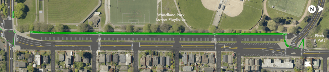 Two-way protected bike lane through the Woodland Park Lower Playfields Parking Lot.