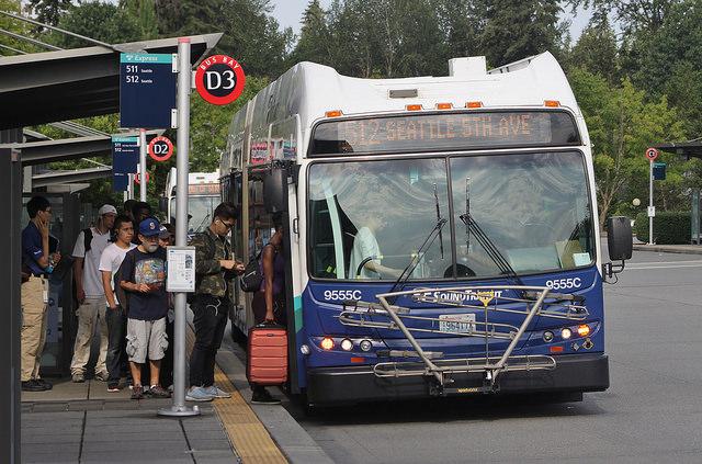 Commuters in Lynnwood wait in line before boarding. (Bruce Englehardt)