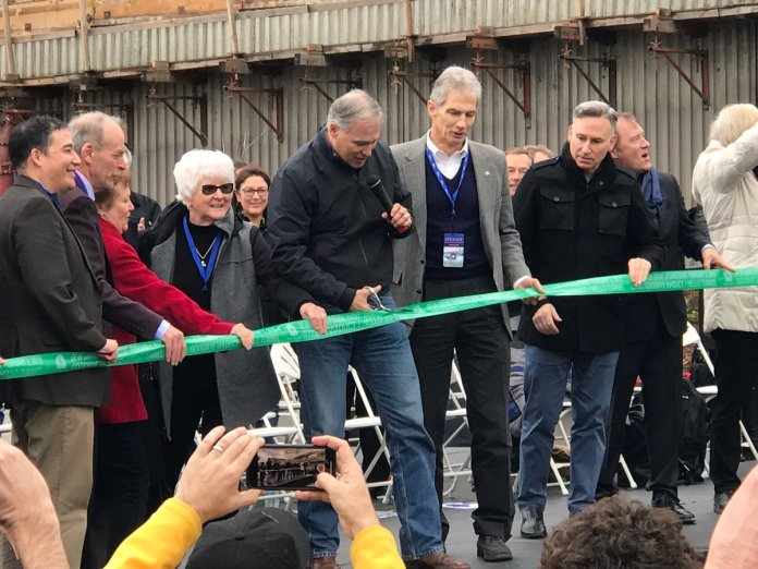 Inslee holds the scissors and other high-level officials look on outside the SR-99 tunnel in February 2019.